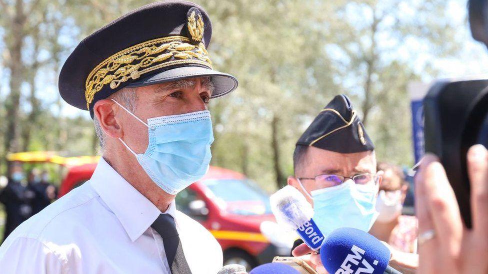 Dordogne department prefect Frédéric Périssat speaks to reporters
