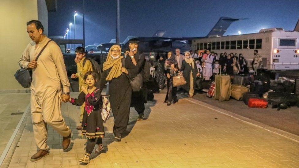 Evacuees from Afghanistan arrive at Al-Udeid airbase in Doha, Qatar (17 August 2021)