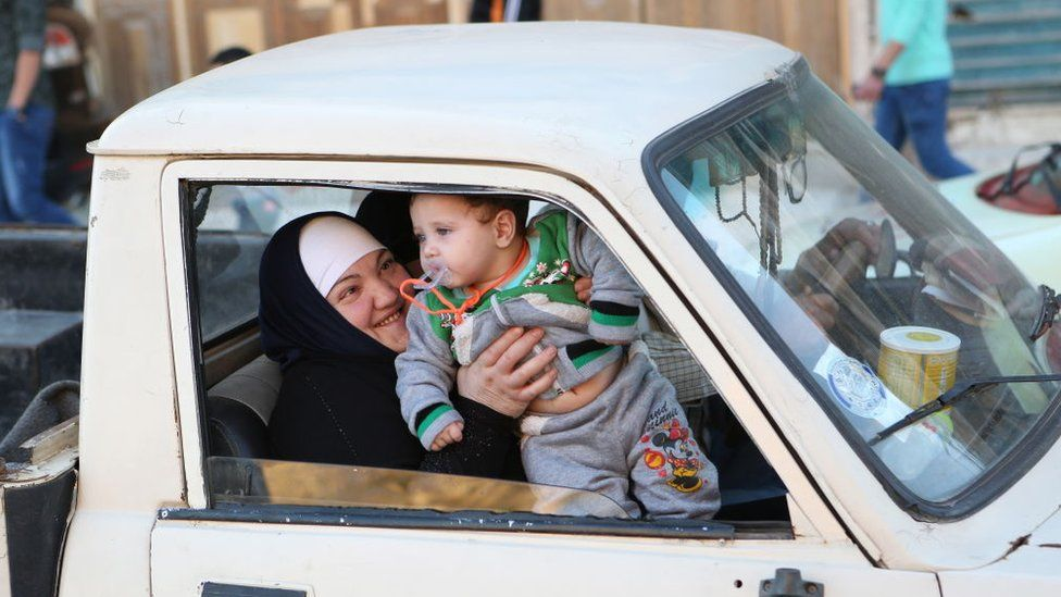 Syrian woman with child, file pic