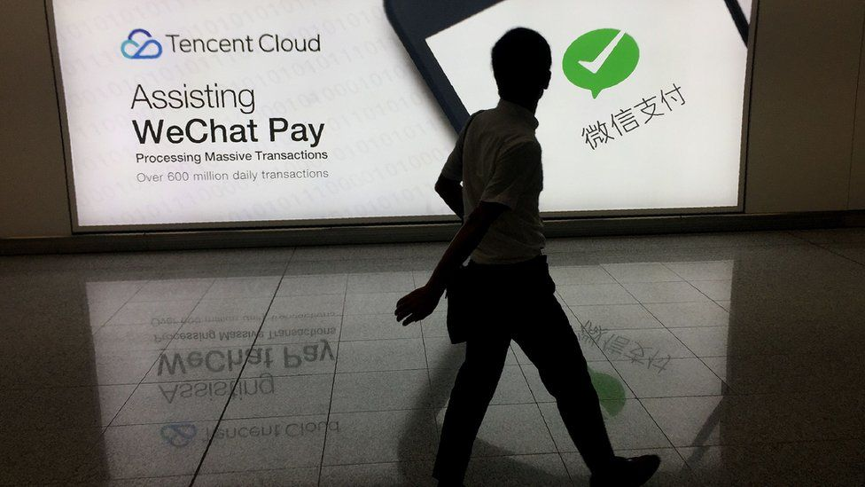 Man walks pay WeChat Pay ad