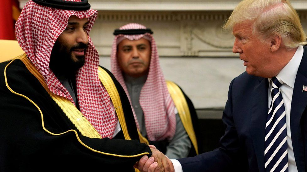 Saudi Crown Prince Mohammed bin Salman shakes hands with US President Donald Trump at the White House on 20 March 2018