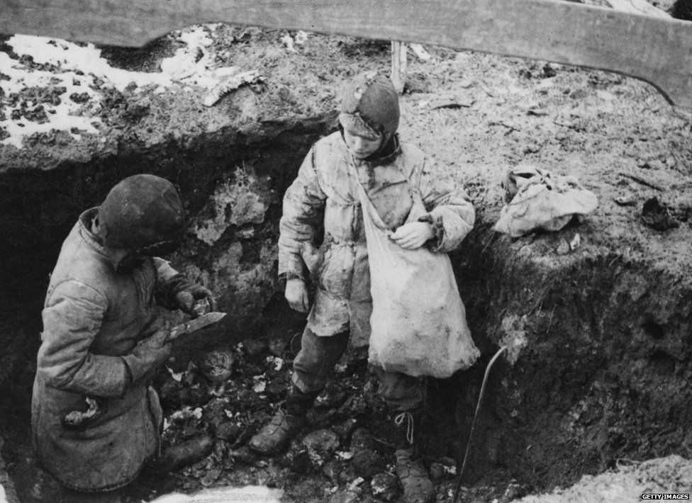 Two boys with a cache of potatoes they have found during the man-made Holodomor famine in the Ukraine, former Soviet Union, Spring 1934