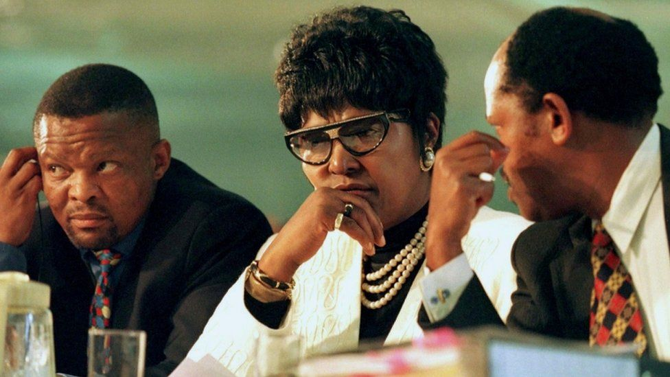 Winnie Madikizela-Mandela and members of her legal team listen to the testimony of one of the witnesses at a special public hearing of South Africa's Truth and Reconciliation Commission in 1997