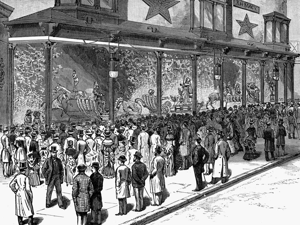 Crowds view Macy's highly decorated Christmas windows in a wood engraving from an American newspaper in 1884