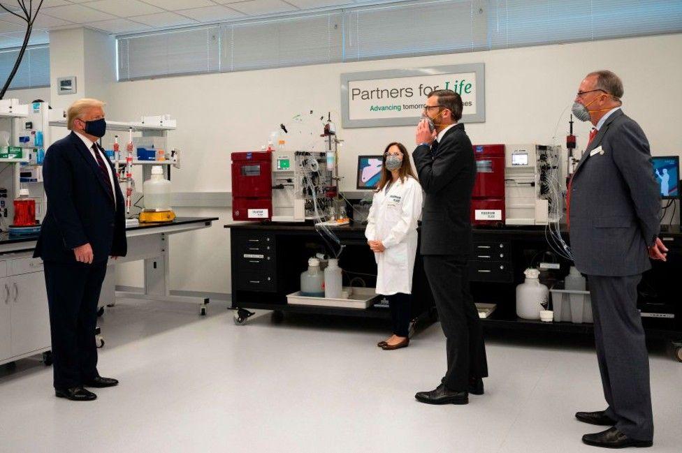 US President Donald Trump wears a mask alongside Fujifilm Diosynth Biotechnologies