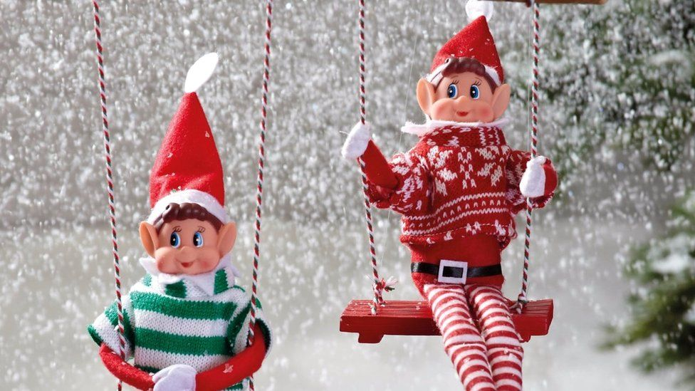 Naughty elves in a snowy scene