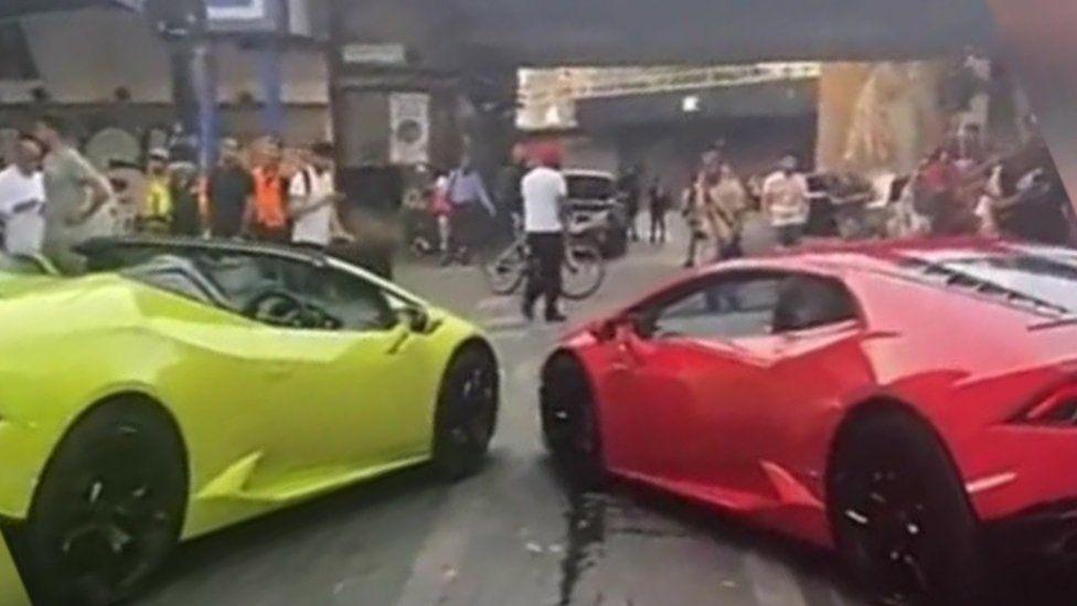 Sports cars at scene