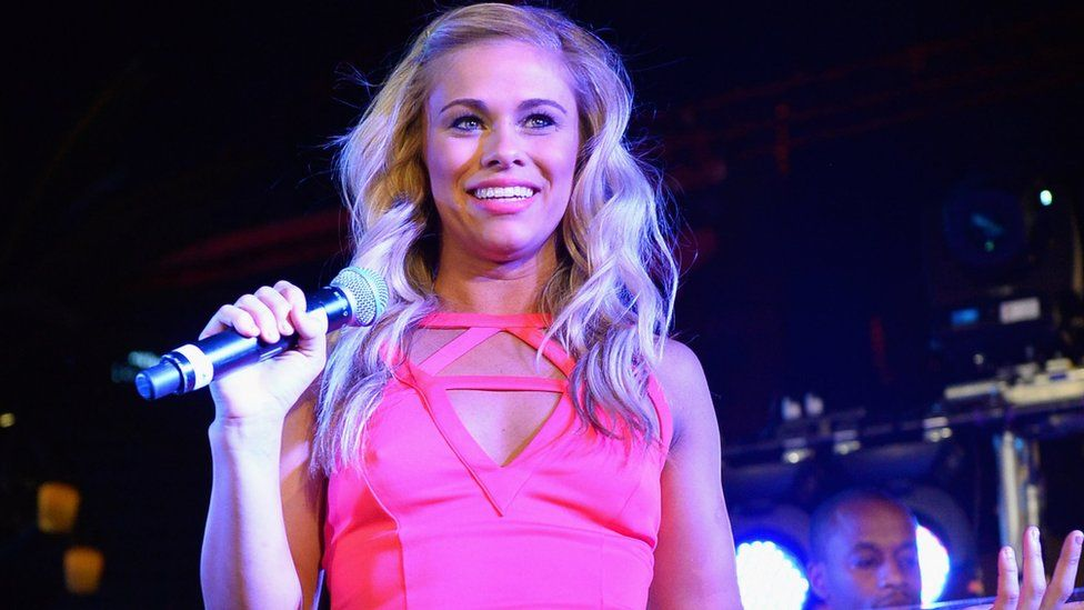 Paige Vanzant in a pink dress