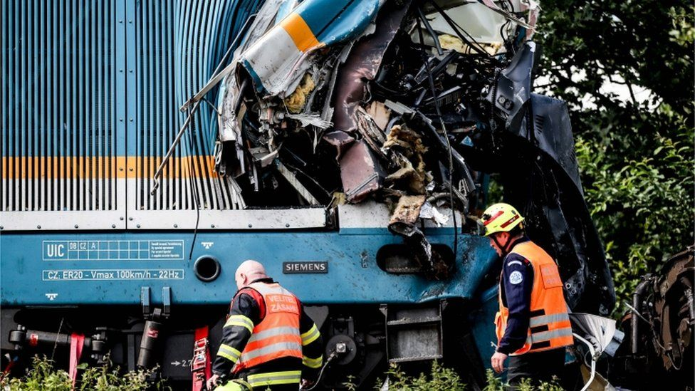 Rescue workers at the scene of a train crash near the German-Czech border