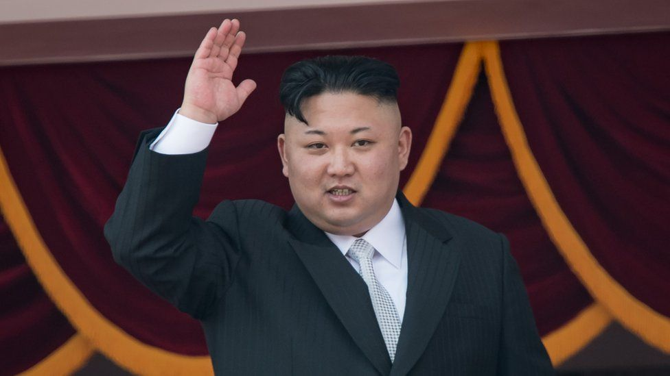 """This file photo taken on April 15, 2017 shows North Korean leader Kim Jong-Un waving from a balcony of the Grand People""""s Study house following a military parade marking the 105th anniversary of the birth of late North Korean leader Kim Il-Sung, in Pyongyang."""