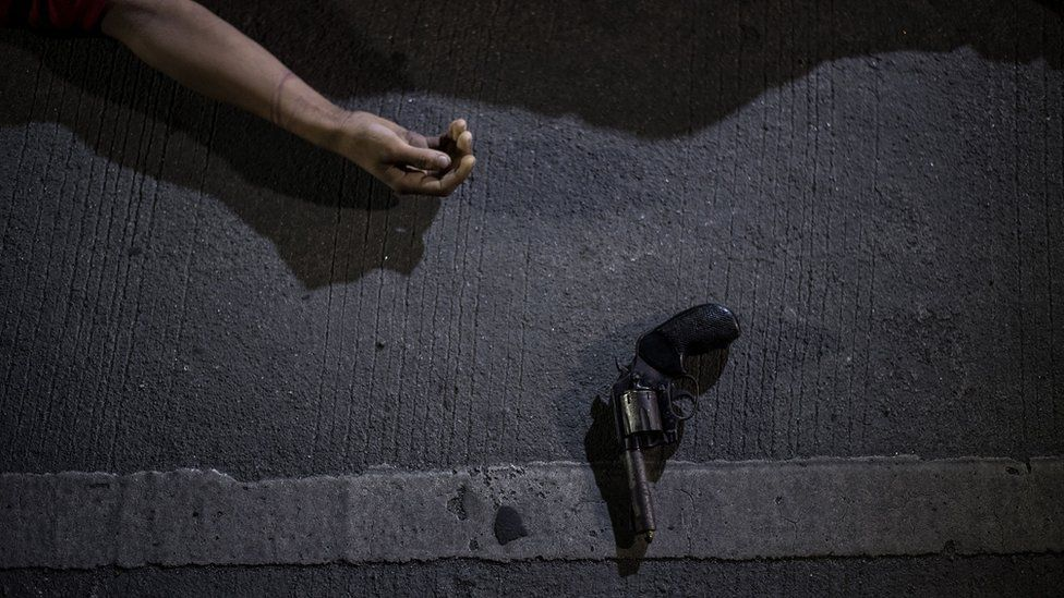 The body of an alleged drug dealer killed during a police anti-drug operation is seen on the ground in Manila on August 18, 2017.