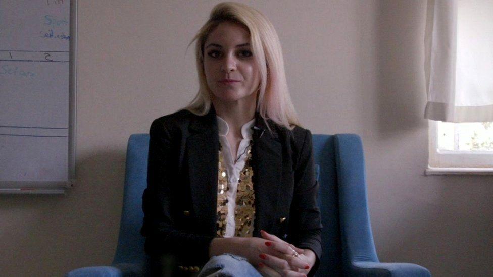 Leila sitting down