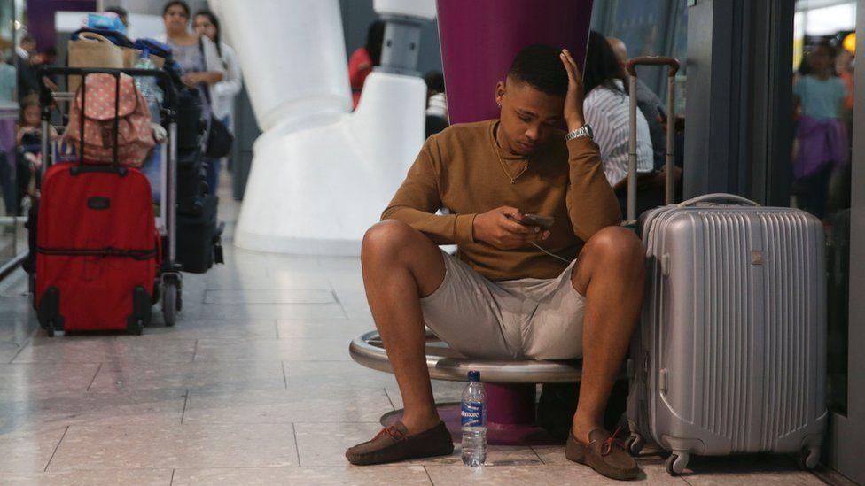 Man waits at airport