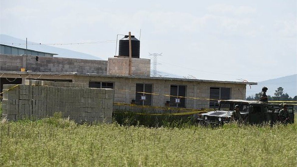 Military and police personnel patrol the house where the tunnel through which Mexican drug lord Joaquin 'El Chapo' Guzman escaped from the Altiplano prison ended, in Almoloya de Juarez, Mexico, on 13 July, 2015