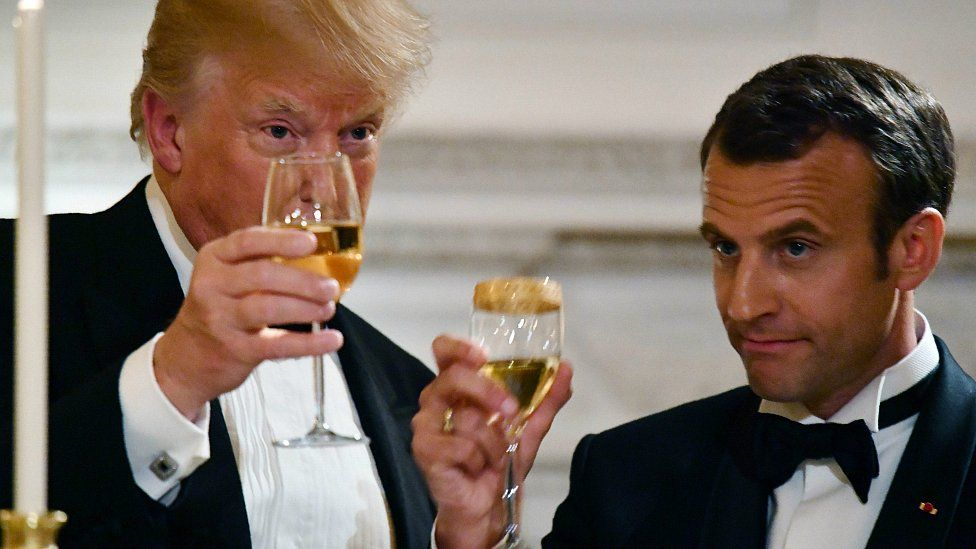 US President Donald Trump and French President Emmanuel Macron toast during a State Dinner at the White House, April 24, 2018