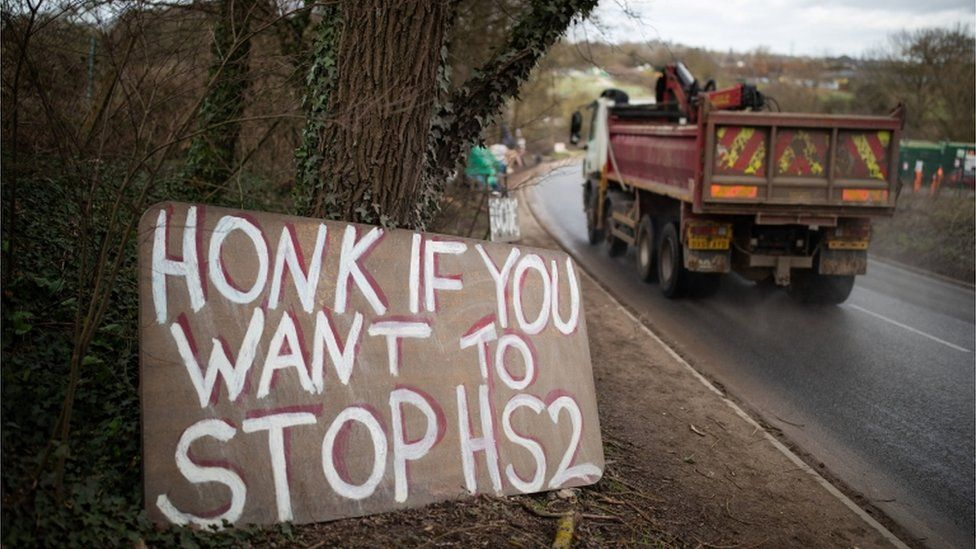 """A sign saying """"honk if you want to stop HS2"""""""