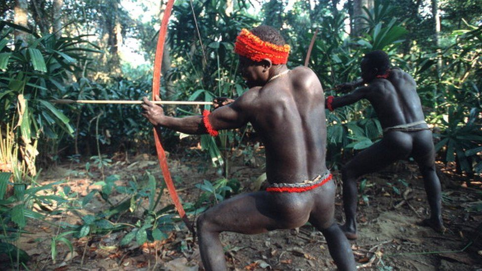 Two Jarawa men shooting a bow and arrow