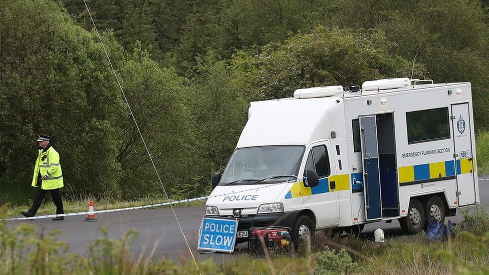 Police officers were at the scene where the body was found