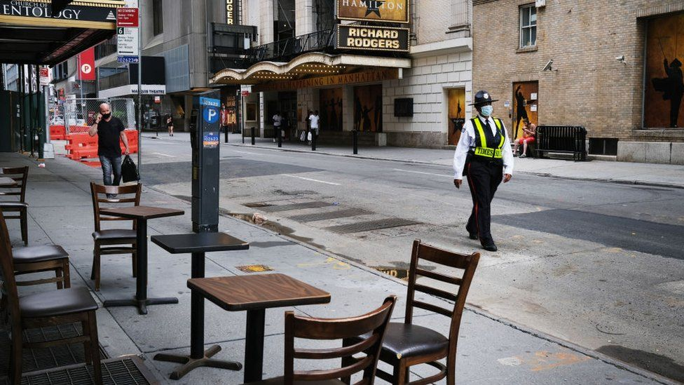Empty outdoor seats at a New York restaurant