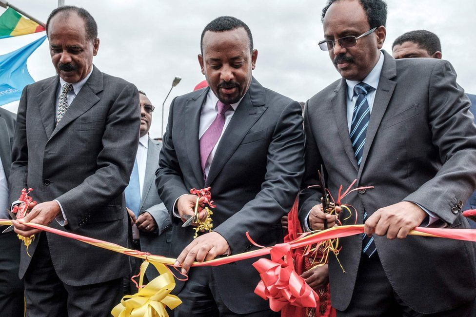 L-R: Eritrea's President Isaias Afwerki, Ethiopia's Prime Minister Abiy Ahmed and Somalia's President Mohamed Abdullahi Mohamed cut the ribbon at the Tibebe Ghion Specialised Hospital in Bahir Dar, Ethiopia - Saturday 10 November 2018