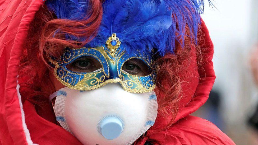 Venice Carnival reveller wearing a face mask