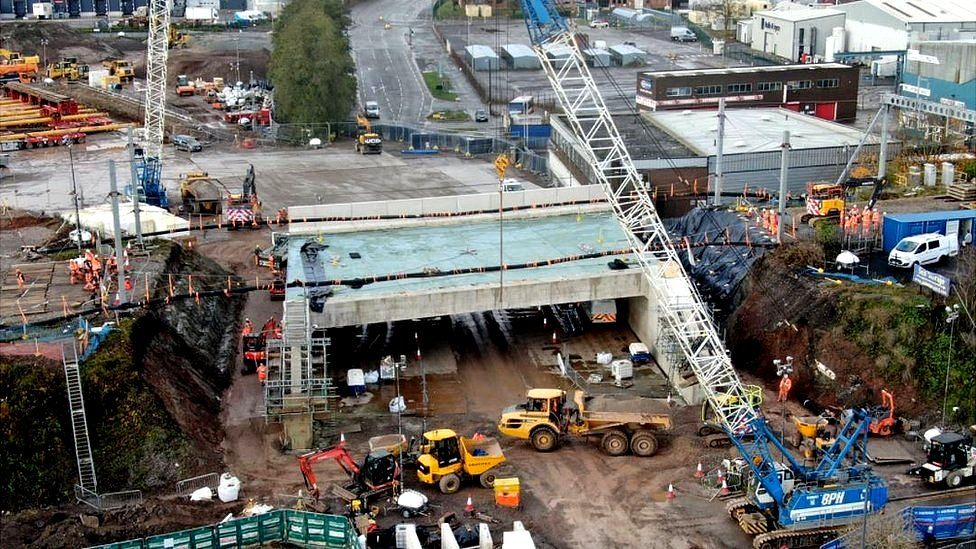 Railway bridge being moved into place