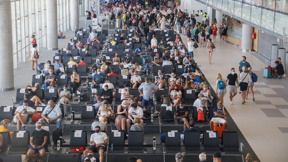 People wait for planes at Split airport, as Croatia struggles with more cases of coronavirus disease (COVID-19), in Split, Croatia August 20, 2020
