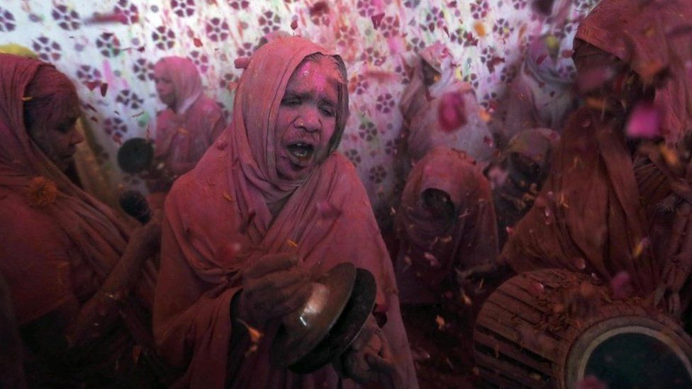A widow daubed in colours takes part in the Holi celebrations organised by non-governmental organisation Sulabh International at a ashram at Vrindavan, in the northern state of Uttar Pradesh,