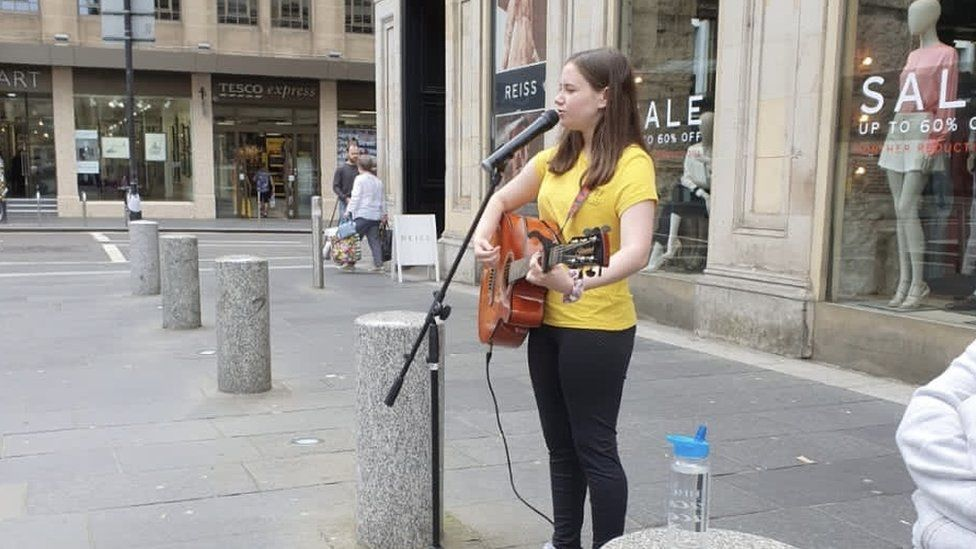 Caitlin busking in Glasgow city centre