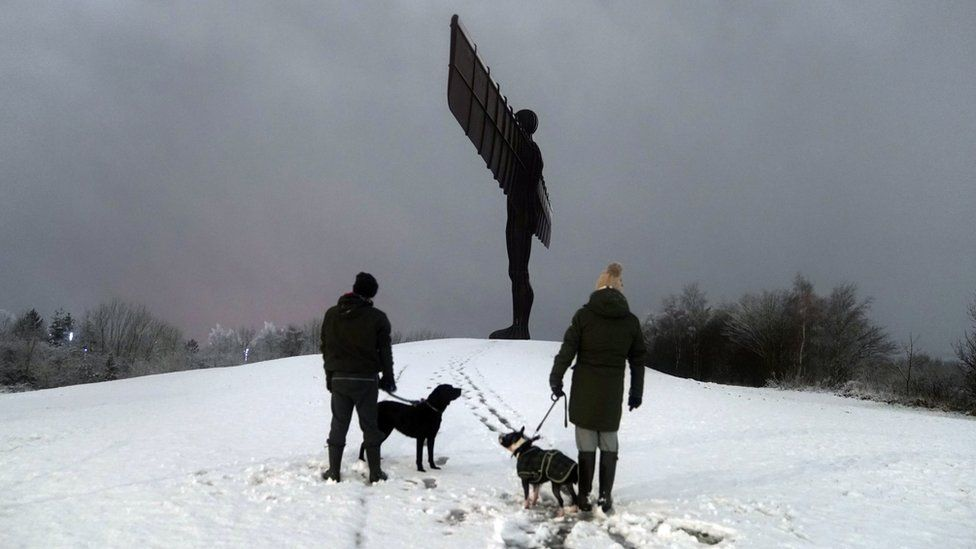 Dog walkers at the Angel of the North