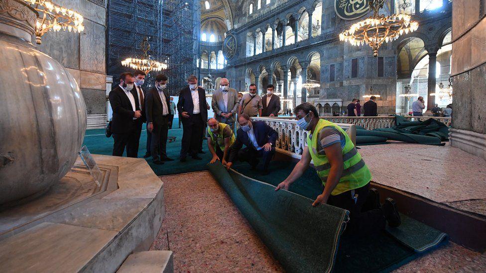 Head of Turkey's Religious Affairs Directorate Ali Erbas visits Hagia Sophia or Ayasofya-i Kebir Camii as workers lay carpets in Istanbul on 22 July