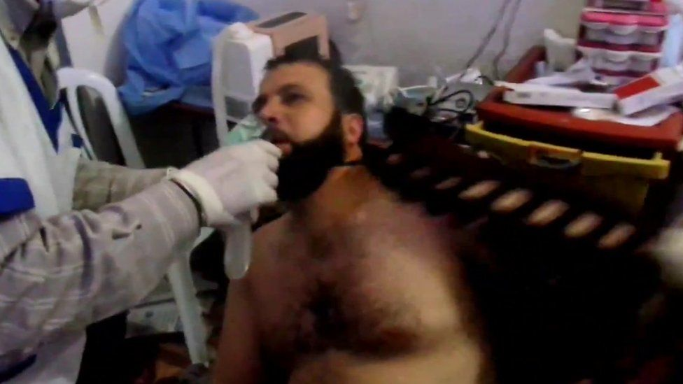 A Syrian man is treated in the aftermath of an alleged chemical weapons attack