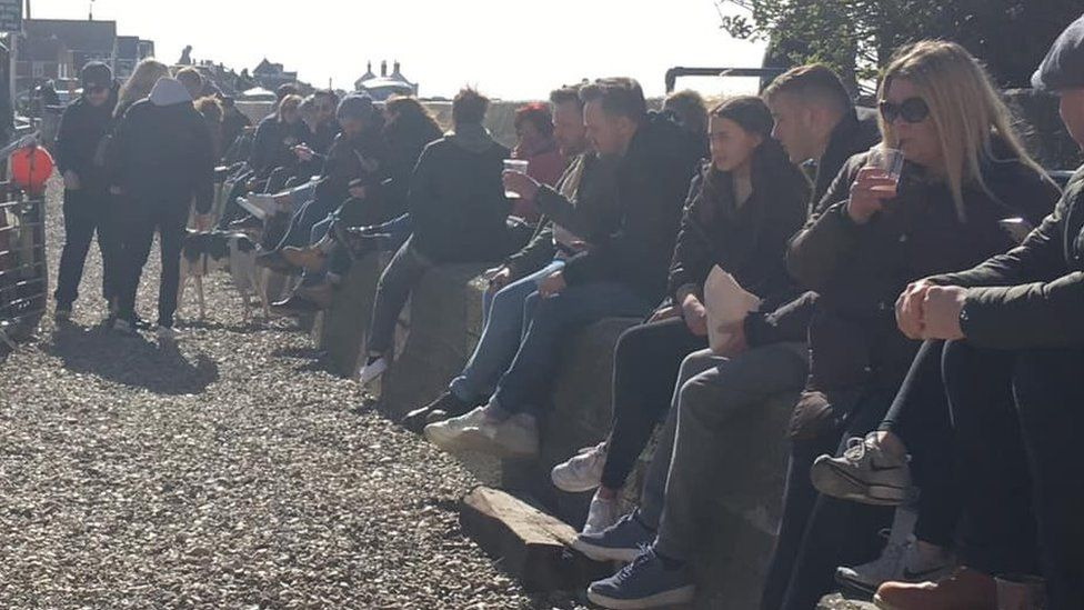 People sit on wall