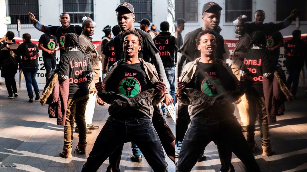 Members of Black First Land First (BLF) movement demonstrate outside an Absa Bank branch in downtown Johannesburg, on June 28, 201