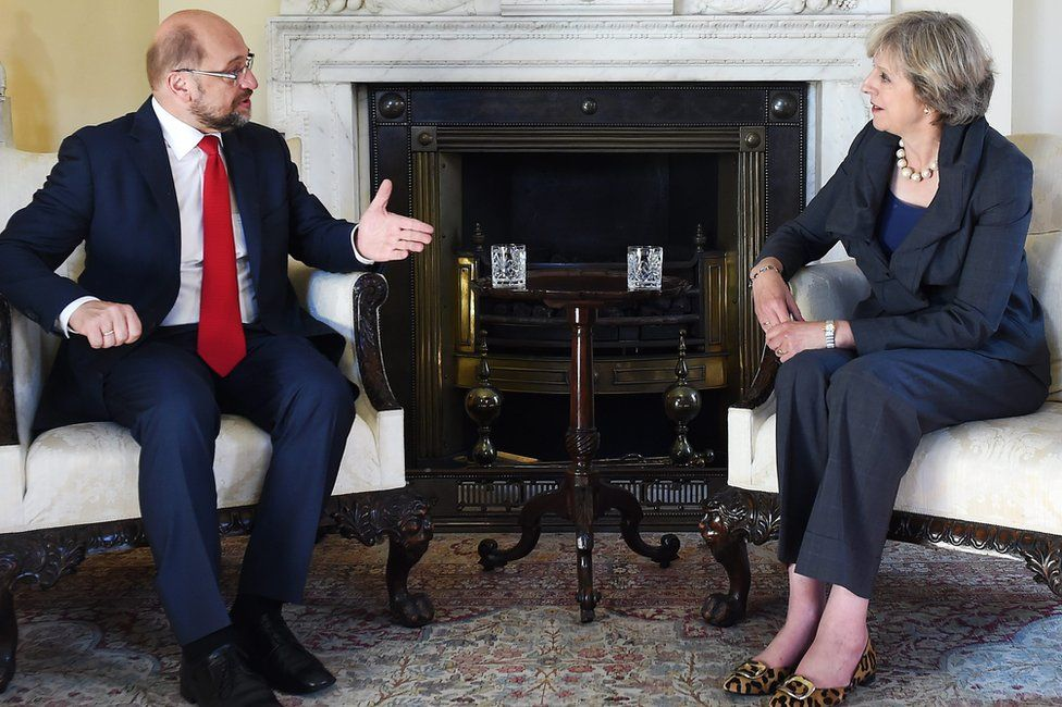 European Parliament President Martin Schulz chats with UK Prime Minister Theresa May in Downing Street