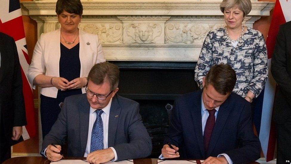 The Conservatives and Democratic Unionists signing the confidence and supply agreement