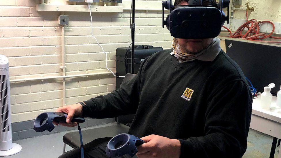 Metro driver Craig Pearson using the VR headset