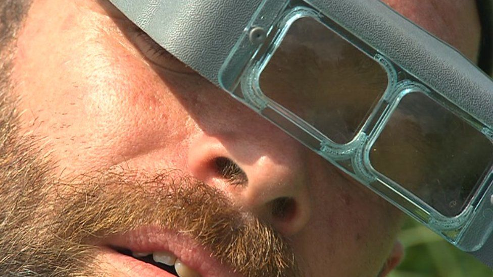 Man in magnifying goggles