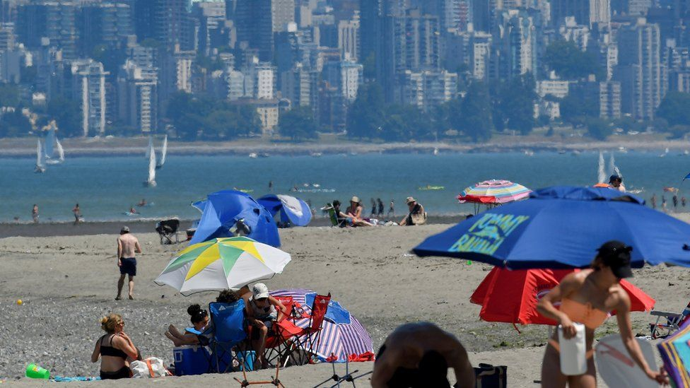 People head to the beach to cool off during the scorching weather of a heatwave in Vancouver,