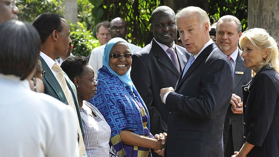 Joe Biden talk to employees and survivors of former US embassy in Nairobi on a visit to Kenya in June 2010