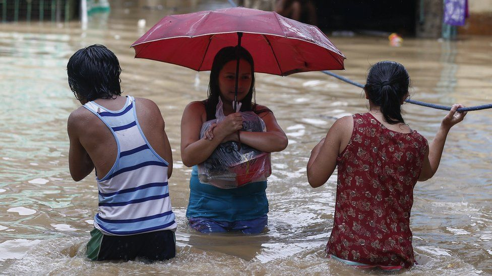 residents in floodwaters in San Mateo east of Manila