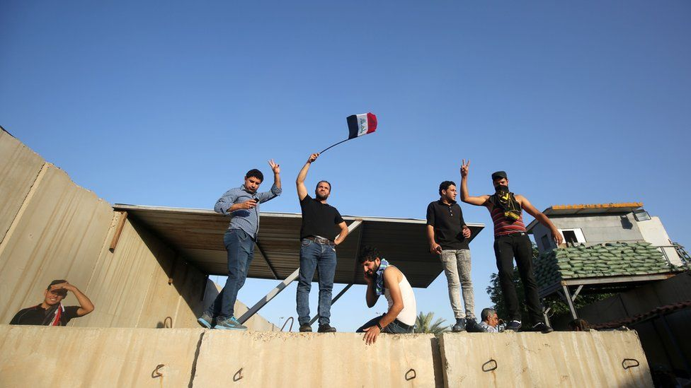Supporters of Iraqi cleric Moqtada al-Sadr chant slogans after breaking into Baghdad's fortified Green Zone on May 20