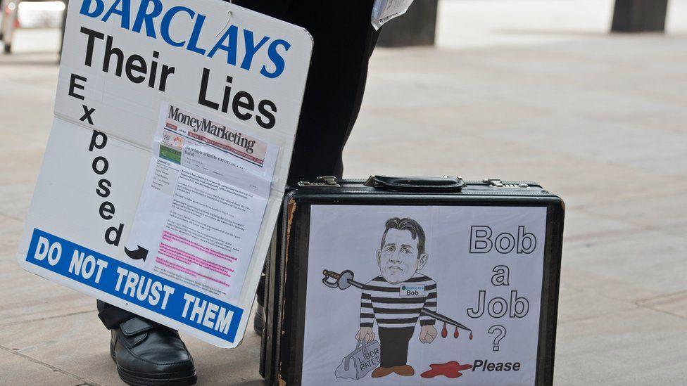 Cartoon of Bob Diamond on protestor's briefcase