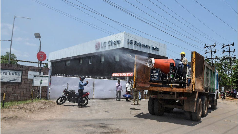 Municipal personnel spray water to mitigate the presence of gases in the air a day after a gas leak incident around the area of LG Polymers plant in Visakhapatnam