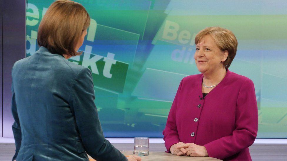 Merkel (R) appears on ZDF