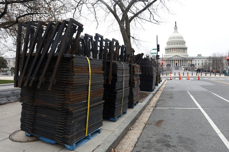 Stacks of security fencing are seen near the US Capitol in preparation for the upcoming inauguration of President-elect Donald Trump, 16 January