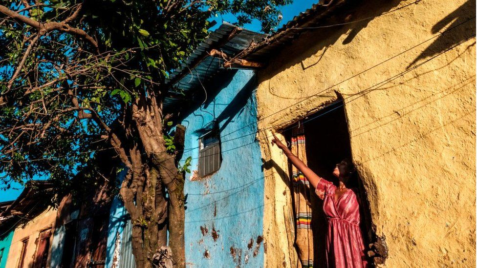 A woman points out from a house in Gondar, Ethiopia, on November 23, 2020.