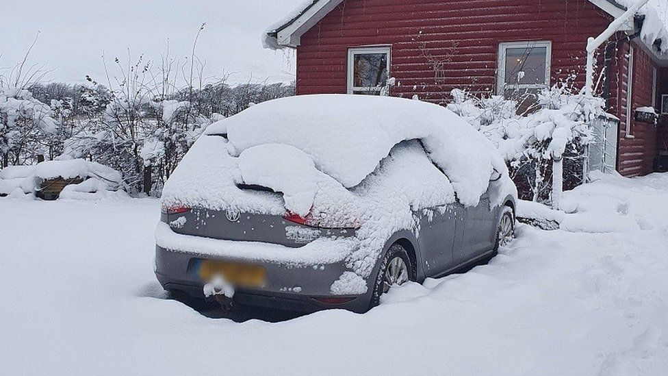 A snow-covered car in Carlops, in the Scottish Borders