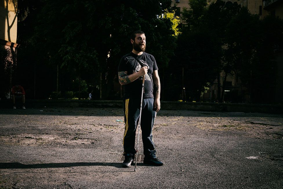 A man stands in the street