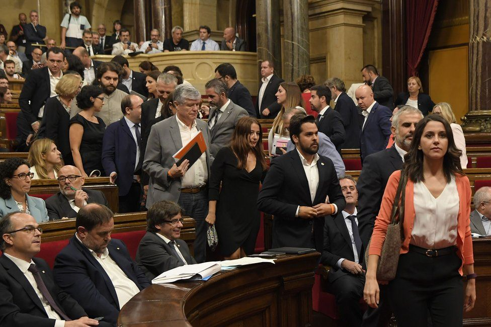 Unionist MPs leave the Catalan parliament in Barcelona, 6 September